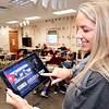 John P. Cleary |  The Herald Bulletin<br /> Alexandria Intermediate School teacher Shannon Howell looks at one of the student-led school announcement videos her students have produced.  Howell has turned to the Donors Choose crowdfunding site for teachers to raise money to purchase video equipment for her students to use.