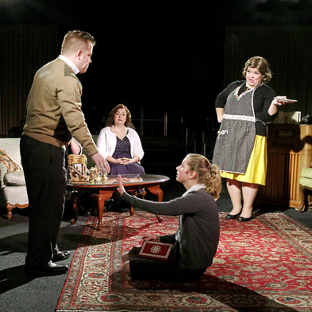 Mark Maynard   for The Herald Bulletin<br /> George Stookey (Cameron Vale) suffers the effects of Raisa Chernenko's  (Kathleen Wile) vodka-laced fruit cake as his sister Gloria (Julie Beeler) and mother Delores  (Gretchen Stapleton) react.