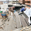 John P. Cleary |  The Herald Bulletin<br /> Jason Shepherd and Kyle Walford, of Shepherd Homes, maneuver this large granite step into place Monday afternoon as they work on the west entrance of the Madison County Government Center. Shepherd said with the holiday being Monday and the above-normal temperatures made for a good day to accomplish allot of work on the project.