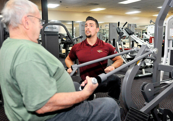 John P. Cleary |  The Herald Bulletin<br /> LivRite Fitness personal trainer Trenton Priser, right, works with Jerry Shaul, of Pendleton, on a compound rowing machine Friday afternoon at the facility.