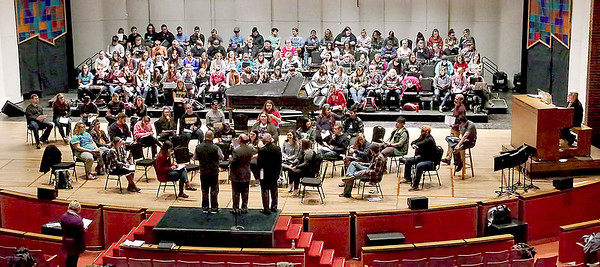 "Mark Maynard | for The Herald Bulletin<br /> Members of the Anderson University Music Department assemble for a technical walk-through rehearsal in preparation for their ""Candles & Carols"" Christmas Concert at Reardon Auditorium."