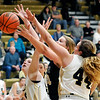John P. Cleary |  The Herald Bulletin<br /> Lapel's Breanna Boles tries to grab the rebound between Madison-Grant's Dayla Comer and McKenna Lugar with the ball being batted out of bounds.