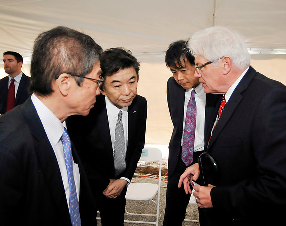 John P. Cleary   The Herald Bulletin  <br /> NTN Driveshaft groundbreaking. Mayor-elect Tom Broderick Jr. talks with NTN officials in this Nov. 17, 2015 file photo.
