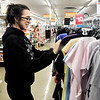 John P. Cleary |  The Herald Bulletin<br /> Jasmine Clark, 17, the oldest of Kassandra Zachary's three children, shops for cloths Monday at the Elwood Kmart. The shopping trip for the children was made possible by the Fire Rescue House of Madison County and the Elwood Fire Department after the family was burnt out of their home Nov. 30th.