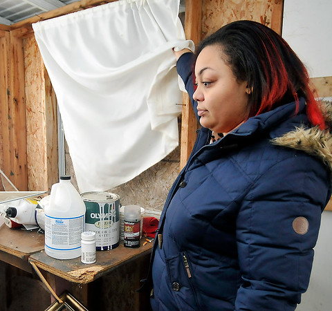 John P. Cleary |  The Herald Bulletin<br /> Pamela Graves had her house ransacked Christmas Eve with thieves kicking in a back door and breaking out this window to gain access.