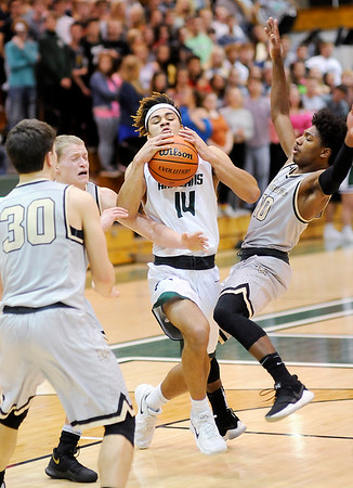 Don Knight |  The Herald Bulletin<br /> Mt. Vernon's Damari Gatewood is called for a foul for colliding  with Pendleton Heights Eli Pancol on Friday.