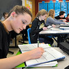 John P. Cleary |  The Herald Bulletin<br /> Mia Stewart works on her assignment in Cristi Burman's English 11 Honors class at Madison-Grant High School this past week.