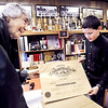 John P. Cleary |  The Herald Bulletin<br /> Emilie Eisenhower, a trustee at the Madison County Historical Society, checks out the 1919 AHS diploma Cael Alexander, 12, found behind a framed picture of Jesus he bought.