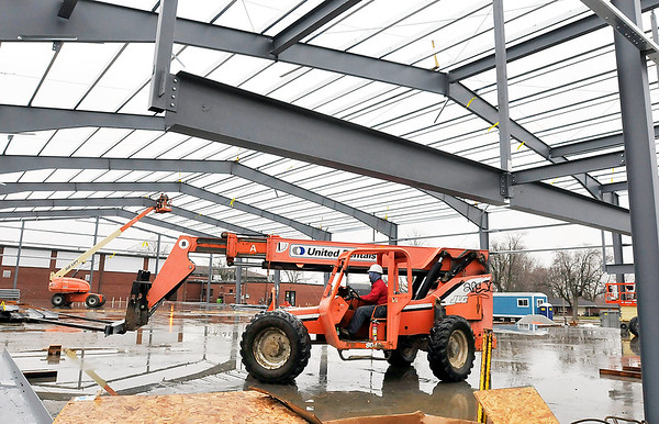 John P. Cleary |  The Herald Bulletin<br /> The new Anderson Township Trustee Youth Center field house was taking shape Friday as workers from Alpha Steel Erectors, Inc. have most of the steel frame work completed on the $2 million project.