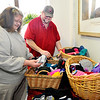 John P. Cleary |  The Herald Bulletin<br /> Volunteer Vera Griffin and Christian Center food service coordinator Cordell Ford sort out items that were donated to the center through the Anderson Public Library's Warming Tree.