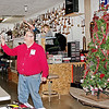 "Mark Maynard | for The Herald Bulletin<br /> Auctioneer Mike Schott, assisted by Auction Clerk Sandy Barkdull, takes a bid while Ringman Jeff Sweatland encourages the bidders during Schott's ""Sell It Again Christmas Tree Auction.""  On Saturday, a total of $455.00 was raised for the Alexandria Toy Drive by repeatedly selling this uniquely decorated tree."