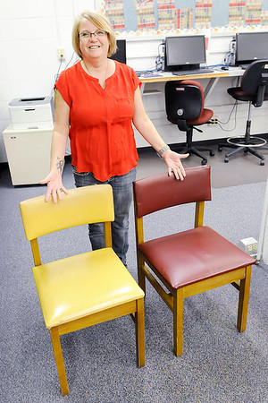 Don Knight    The Herald Bulletin<br /> Alexandria-Monroe librarian Celisa Rambo wanted to improve the learning environment for her students so she started reupholstering the chairs in the library. At left is a chair before and on the right is a upholstered chair.