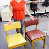 Don Knight |  The Herald Bulletin<br /> Alexandria-Monroe librarian Celisa Rambo wanted to improve the learning environment for her students so she started reupholstering the chairs in the library. At left is a chair before and on the right is a upholstered chair.