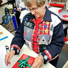 John P. Cleary |  The Herald Bulletin<br /> Judy Barron, of Moneyhun's Fine Gifts, puts the finishing touches on this gift wrapping for a customer Monday afternoon.