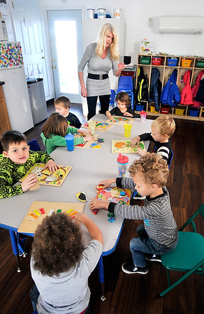 John P. Cleary |  The Herald Bulletin<br /> Giggles & Grins Day Care owner Jamie Goulding works with children in her level IV accredited day care facility this week.
