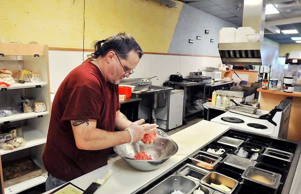 John P. Cleary    The Herald Bulletin<br /> Roger Koker, co-owner of Hungryman's Friend Cafe, makes up beef patties in the downtown restaurant Wednesday afternoon. The business is closing because of two family emergencies Roger and his wife Kate are dealing with.