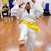 Don Knight |  The Herald Bulletin<br /> Kevin Henson uses a damp cloth to keep cool during a Kick-A-Thon fundraiser at the Training Academy of Shotokan Karate at the Mounds Mall on Friday. Students get pledges and then perform as many kicks as they can in one hour to raise money to help families in need this Christmas.