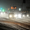 Don Knight |  The Herald Bulletin<br /> Motorists slow down as snow covers Scatterfield Road on Friday evening. Madison County Emergency Management issued a travel advisory Friday evening and the area is under a winter storm warning until 4 a.m. Saturday.