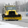 Don Knight |  The Herald Bulletin<br /> An INDOT snow plow travels north on Indiana 9 after Madison County received its first snowfall of the season on Saturday.