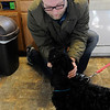 Don Knight |  The Herald Bulletin<br /> Aaron Walters pets his labradoodle Ocho after he was micro chipped at the Madison County Humane Society during their Holiday Open House on Saturday. A donation from Thrivent Financial allowed the Humane Society to offer micro chips at a reduced cost for the open house. The Humane Society offers micro chips, nail clippings and heart worm tests throughout the year during their regular business hours, noon to 5 p.m. Thursday through Tuesdays. They are closed on Wednesdays.