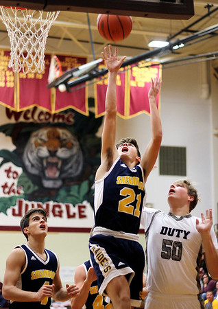 Chris Martin | for The Herald Bulletin<br /> Shenandoah's Andrew Bennett drives to the basket Saturday night at Alexandria.