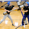 Don Knight |  The Herald Bulletin<br /> From left, Savannah Prewett and Michelle Miranda-Lapez face off as APA wrapped up their third annual Hunger Games on Thursday with pugil stick training. Brelle Rue organized the day of events that included a visit by APD's Marty Dullworth his K-9 partner Rico and Todd Harmeson from EMA.