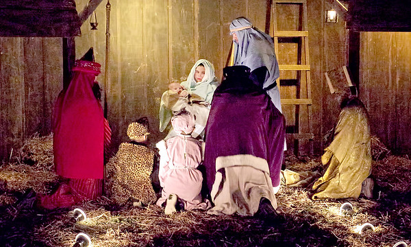 Mark Maynard | For The Herald Bulletin<br /> The Three Wise Men worship the Christ child on bended knee during Maple Grove  Church of God's outdoor living Nativity Pageant.