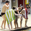 Don Knight |  The Herald Bulletin<br /> Anderson swimmers cheer on their boys 200 freestyle relay team of Payton Harrington, Carson Smitherman, Dayton Edwards and Niah Bozell as the Indians hosted the Pendleton Heights Arabians on Thursday.