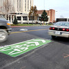 John P. Cleary |  The Herald Bulletin<br /> These large green symbols along Eighth Street through downtown are to remind motorists of the potential for bicycle riders sharing the right-hand lane and the shared traffic space.