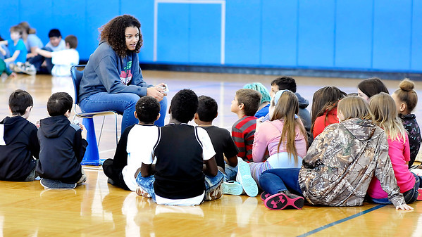 John P. Cleary |  The Herald Bulletin<br /> Sadie McGraw, an Athlete of Character and Anderson High School track runner, talks to a small group of fifth-graders at Erskine Elementary School Friday about the six pillars of character.