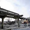Don Knight |  The Herald Bulletin<br /> The west bound section of the Eisenhower bridge is being demolished on Thursday. The new bridge deck will be six feet lower.