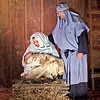 Mark Maynard | For The Herald Bulletin<br /> Mary holds her newborn son, Jesus, as her husband Joseph looks on in the live outdoor Nativity Pageant presented by Maple Grove Church of God; the holy family is portrayed by April and Michael Lakas, and their daughter Kaytlynne.