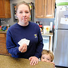 Don Knight |  The Herald Bulletin<br /> Jennifer True holds the ticket stubs from families trip to the Mounds 10 Theatre as her son Jase, 3, looks over the counter. True noticed bites on Jase the next day.