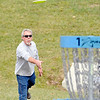 John P. Cleary |  The Herald Bulletin<br /> Trent McPhearson, of Elwood, watches his shot fly toward the basket as  he plays disc golf at the new Sanders Memorial course in Edgewater Park Monday afternoon. McPhearson and his friends were taking advantage of the warm weather to get another round in before the weather turns cold.