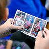 John P. Cleary |  The Herald Bulletin<br /> The Athletes of Character that visited  Erskine Elementary School Friday handed out their playing cards to the students to have during the convo.