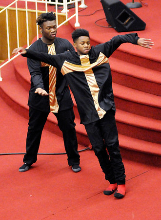 """Don Knight    The Herald Bulletin<br /> Aundray Ivy catches Jalen Coleman as the two perform a dance routine to the song """"Pressure"""" during the Mt. Pilgram Church Youth Christmas Program on Saturday."""