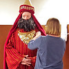 Mark Maynard | For The Herald Bulletin<br /> Anita Paschal assists Daryl Myran with his costume as he prepares for his role as one of the Magi in the live outdoor Nativity Pageant at Maple Grove Church of God.