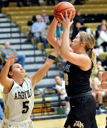 John P. Cleary |  The Herald Bulletin<br /> Lapel's Breanna Boles goes up for a shot as Madison-Grant's Danyelle Hutson tries to defend her.