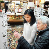 John P. Cleary |  The Herald Bulletin<br /> Sandy Moffett, right, and her granddaughter Olivia Corp, from Georgia, look at key rings while shopping at Moneyhun's Fine Gifts Monday afternoon.