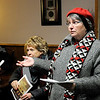 Don Knight |  The Herald Bulletin<br /> Vivian Nieman gives instruction to the Joy Circle at Park Place Church of God before they go out for an evening of caroling.