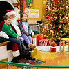 "Don Knight |  The Herald Bulletin<br /> Parker Horkman and Ragan Waldschmidt pose for a photo with Santa at the Mounds Mall on Saturday. Michael ""Wolfie"" Davis portrayed Santa at the mall this season."