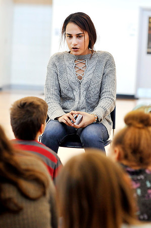 John P. Cleary |  The Herald Bulletin<br /> Cali Rodriguez, an Athlete of Character and Anderson High School tennis player, talks to fifth-graders at Erskine Elementary School Friday about the six pillars of character
