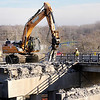 Don Knight |  The Herald Bulletin<br /> Construction crews demo the deck of the westbound lanes of the Eisenhower Bridge on Thursday. After seven years of trying to obtain a federal grant to replace the bridge Madison County received a $13.5 million federal TIGER grant.