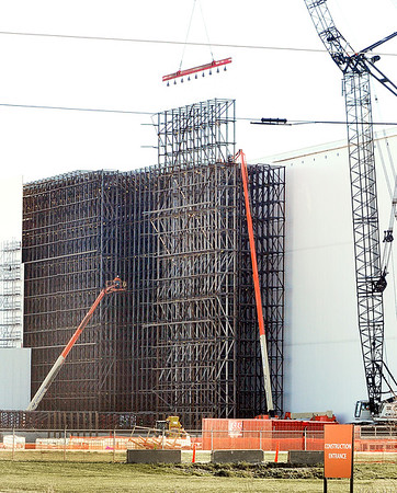 John P. Cleary |  The Herald Bulletin    File photo<br /> Work was going on in this Nov. 29, 2017 file photo of the 30,400 square-foot expansion of the automated storage facility at Nestle as workers were installing large steel panels sections making up the new facility.