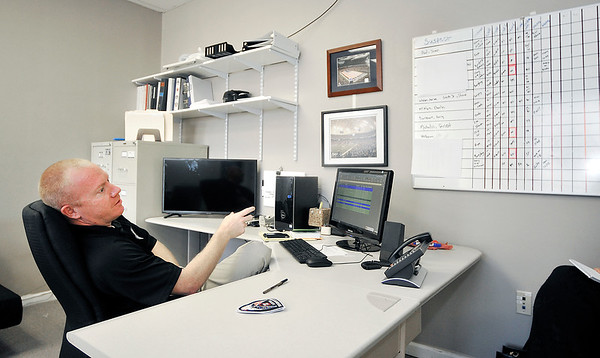 John P. Cleary |  The Herald Bulletin<br /> Detective Brian Holtzleiter, of the Alexandria Police Department, keeps a large board on the wall over his desk with the status of different cases he's working on.