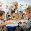 John P. Cleary |  The Herald Bulletin<br /> Giggles & Grins Day Care owner Jamie Goulding helps Wilson Husted, 4, while Javyn Perry, and Benjamin Moran, 3, work on their puzzles at the level IV accredited day care facility this week.