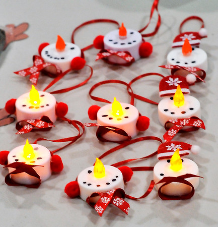 John P. Cleary |  The Herald Bulletin<br /> Snowmen tea lights were one of the items being sold at the <br /> Alexandria Intermediate School Kidpreneur Holiday Market.