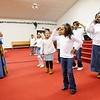 Don Knight |  The Herald Bulletin<br /> Arnette Peak leads the King's Kids and King's Teens in a dance routine during the Mt. Pilgram Church Youth Christmas Program on Saturday.