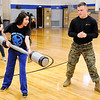 Don Knight |  The Herald Bulletin<br /> Marine PFC Logan Gossett gives APA sophomore Maria Rea pugil stick pointers during the school's Hunger Games on Thursday. Gossett graduated from APA in May and now serves as an armourer in the Marine Corp.