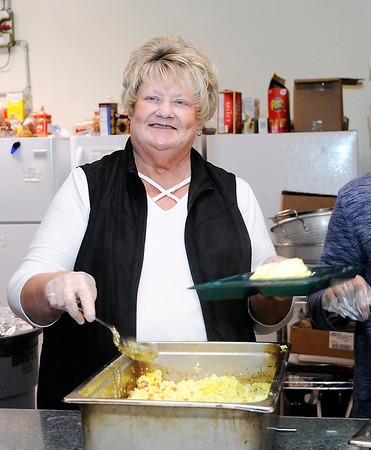 Don Knight |  The Herald Bulletin<br /> Ann Bousman volunteers on the serving line at The Christian Center on Tuesday.